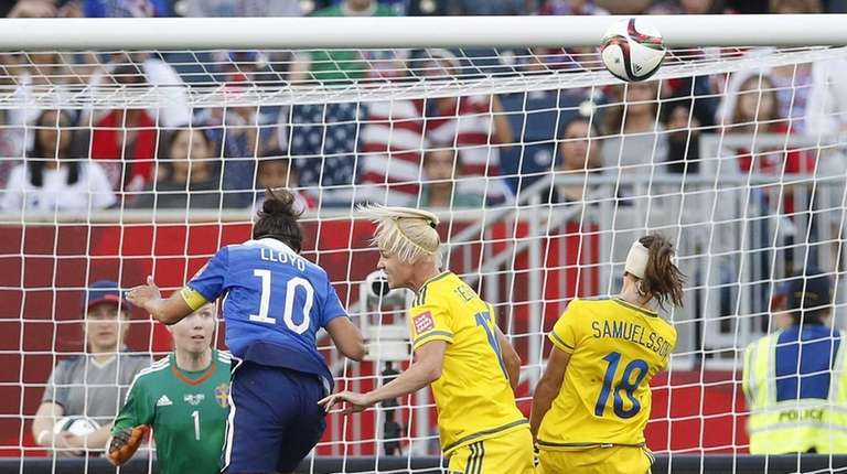 United States' Carli Lloyd's header goes just over
