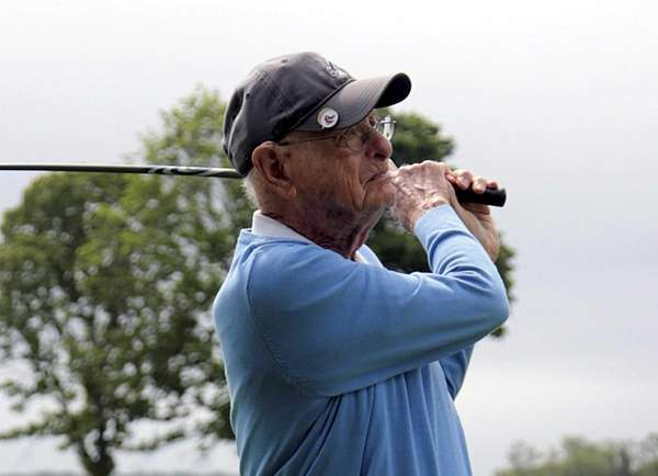 Sid Beckwith follows his tee shot on a