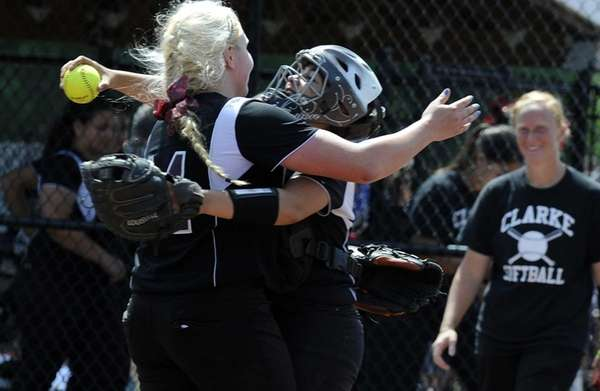 Clarke pitcher Sarah Cornell, left, and catcher Selena