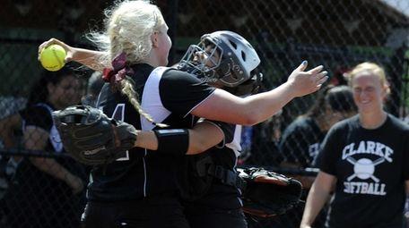 Clarke pitcher Sarah Cornell, left, and catcher Selena