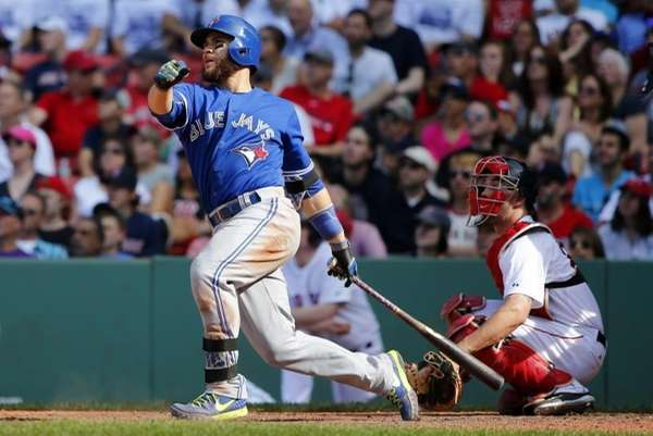 The Toronto Blue Jays' Russell Martin watches his
