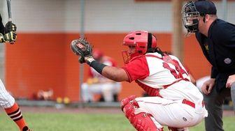 Connetquot catcher Stalem Baez works behind the plate