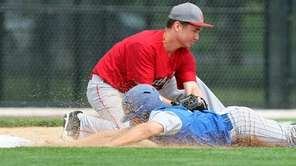 Southold third baseman Greg Gehring puts the tag