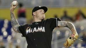 The Miami Marlins' Mat Latos delivers a pitch