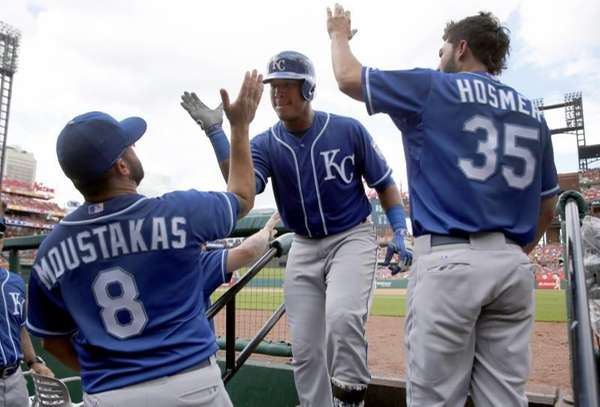 Kansas City Royals' Salvador Perez, center, is congratulated