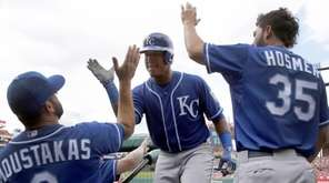 Kansas City Royals' Salvador Perez, center, is congratulated