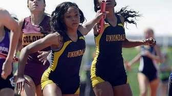 Uniondale's Crystal Green, right, hands the baton to