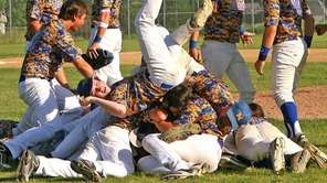 Mattituck baseball team members rejoice after winning the