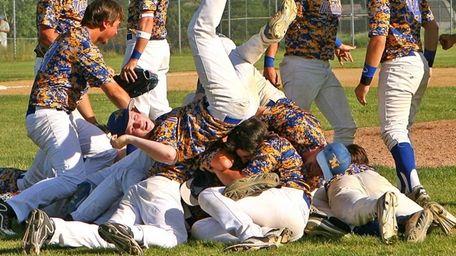Mattituck baseball team members rejoice after winning the