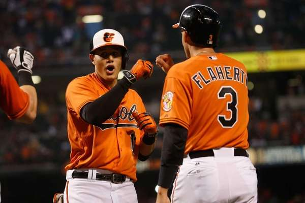 Manny Machado #13 of the Baltimore Orioles celebrates