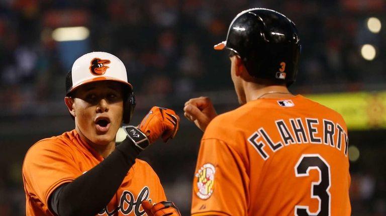 Manny Machado #13 of the Baltimore Orioles celebrates