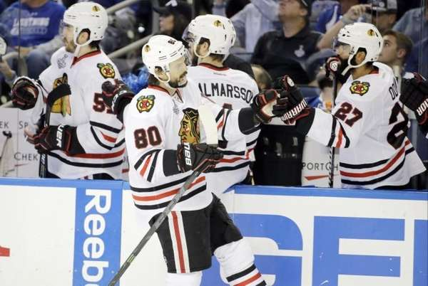 Chicago Blackhawks center Antoine Vermette (80) is congratulated