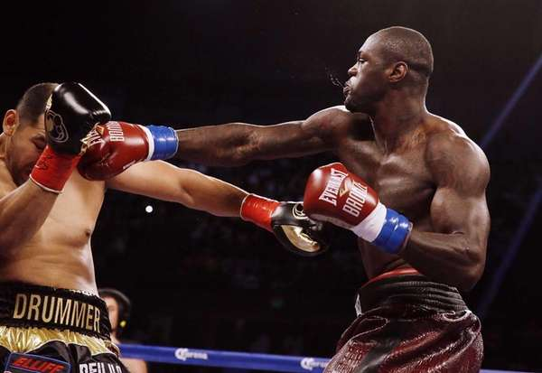 Deontay Wilder, right, punches Eric Molina during the