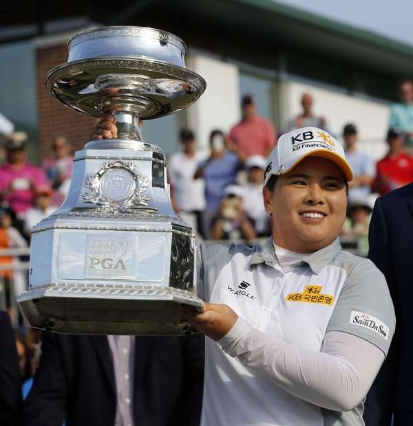Inbee Park poses with the trophy after winning
