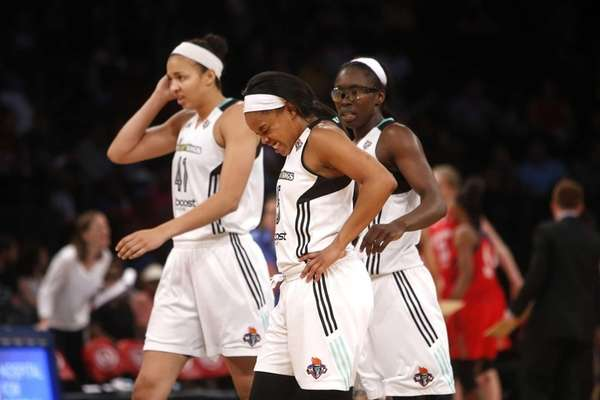 The New York Liberty's Brittany Boyd, center, grimaces
