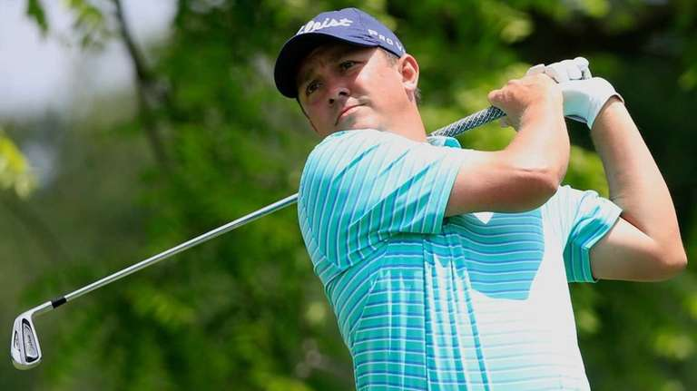 Jason Dufner watches his tee shot on the