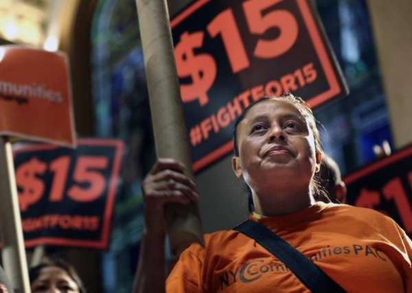 Demonstrators rally for a $15 minimum wage before