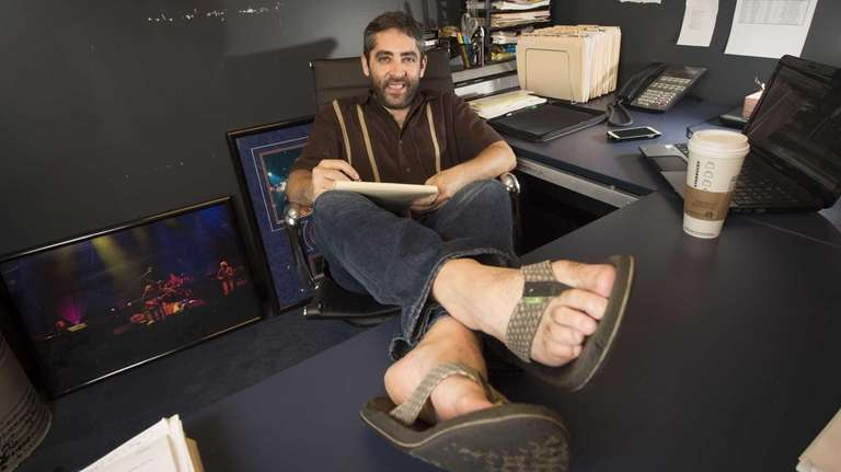 Adam Ellis, sits with his feet up at
