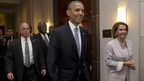 President Barack Obama walks with House Minority Leader