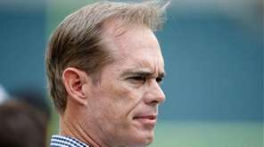 Sportscaster Joe Buck watches pre-game warmups before a