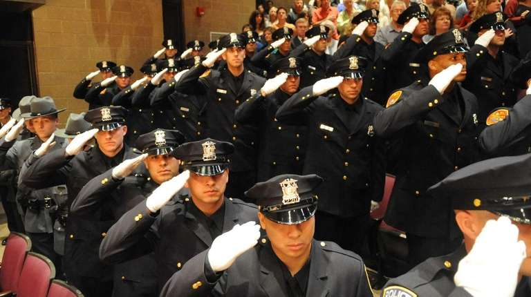 Suffolk County police graduates salute at the Staller