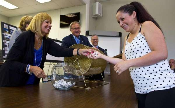 First-time home buyer Wendy Solis, right, of Islip,