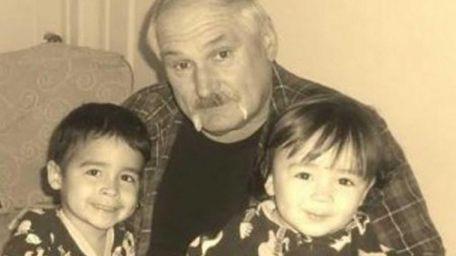 Edward Ross is seen with his grandchildren Eddie,