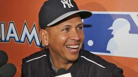 The New York Yankees' Alex Rodriguez talks to