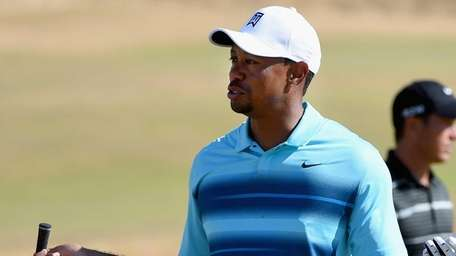 Tiger Woods reacts on a green during a