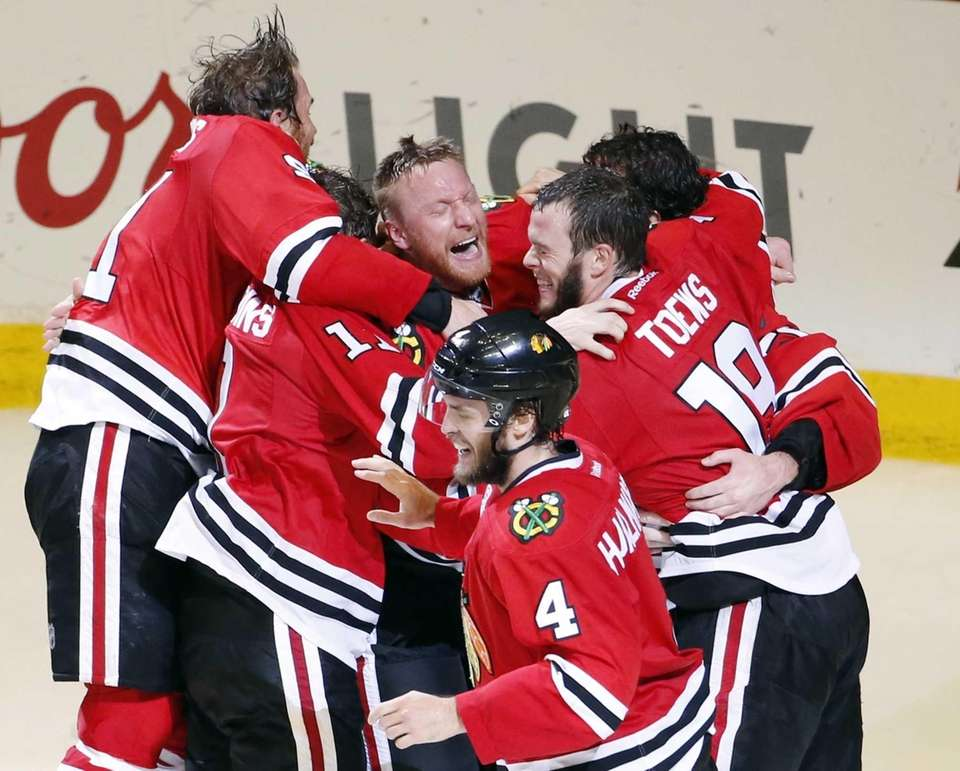 Members of the Chicago Blackhawks celebrate after defeating