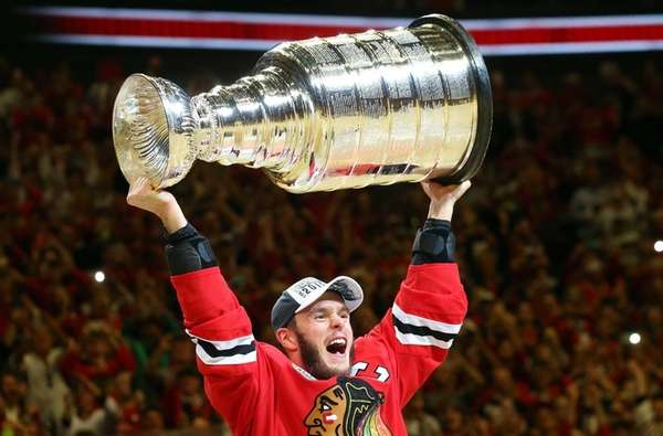 Jonathan Toews #19 of the Chicago Blackhawks celebrates