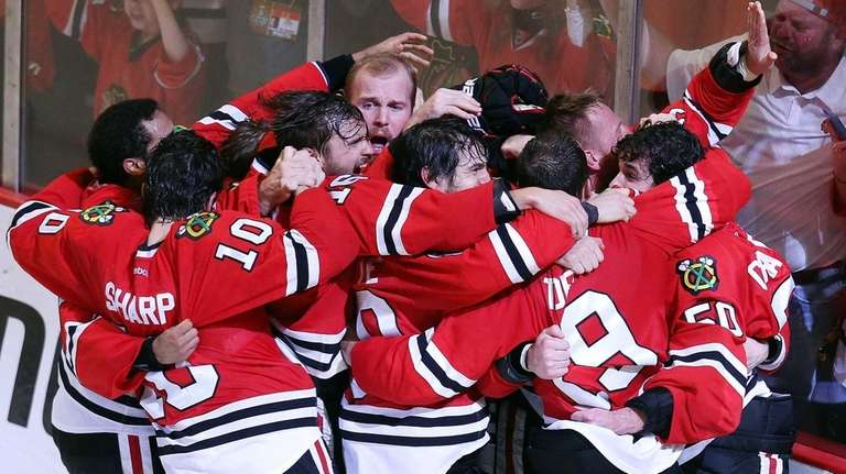 The Chicago Blackhawks celebrate after defeating the Tampa