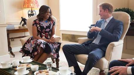 Michelle Obama and Prince Harry at Kensington Palace