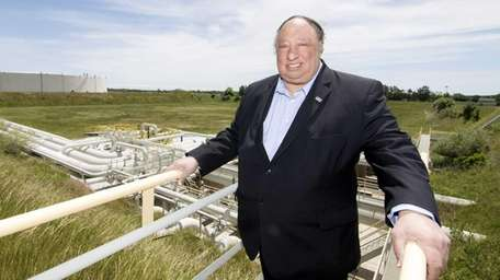 John Catsimatidis stands in a stair above his