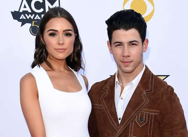 Olivia Culpo and singer/actor Nick Jonas attend the