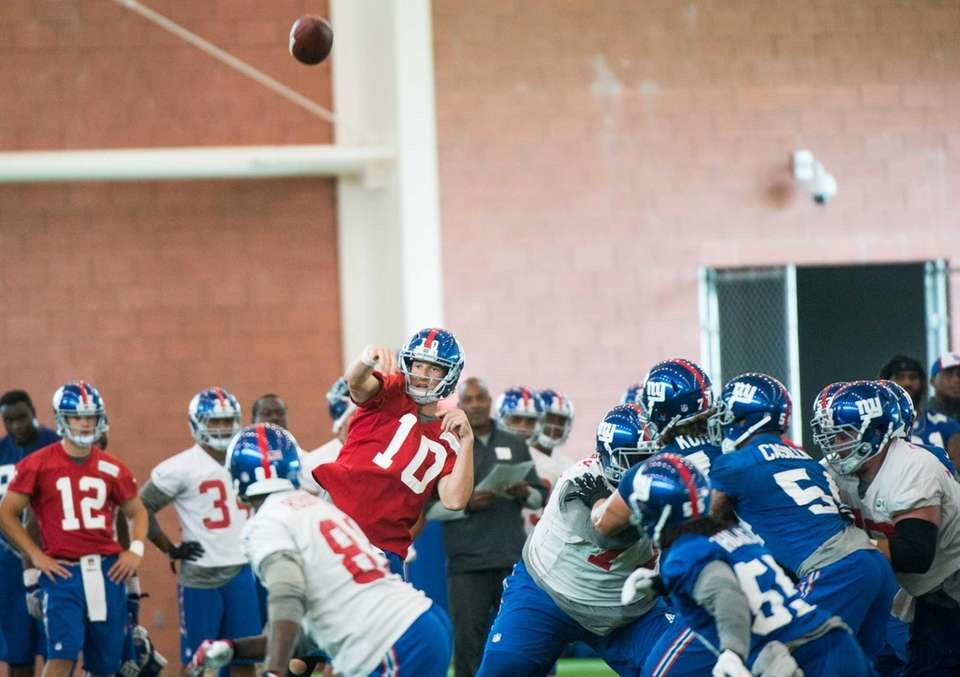 New York Giants quarterback Eli Manning passes the