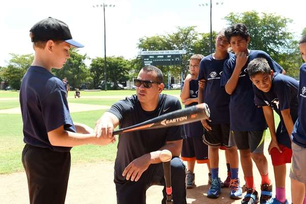 Yankees third baseman Alex Rodriguez works with kids