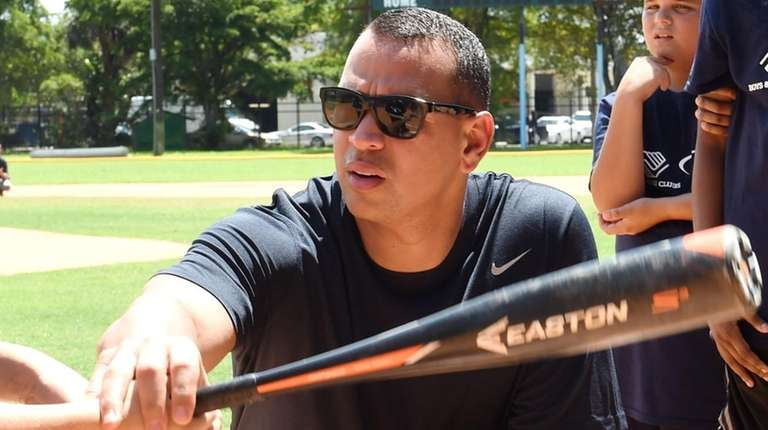 Yankees third baseman Alex Rodriguez works with kids