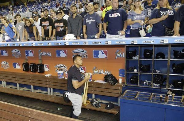 New York Yankees' Alex Rodriguez, below, prepares for