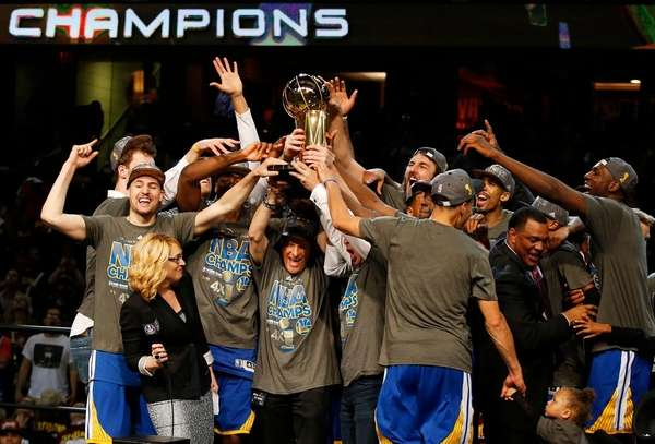 The Golden State Warriors celebrate with the Larry