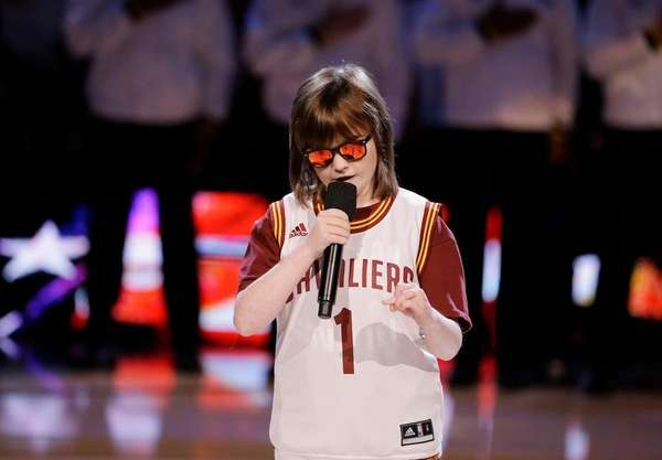 Marlana VanHoose performs the national anthem before the