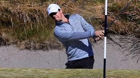 Rory McIlroy of Northern Ireland plays a bunker
