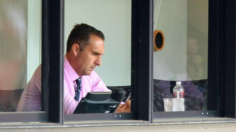 St. Louis Cardinals general manager John Mozeliak sits