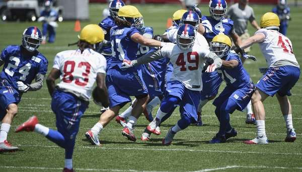 New York Giants fullback Nikita Whitlock #49 runs