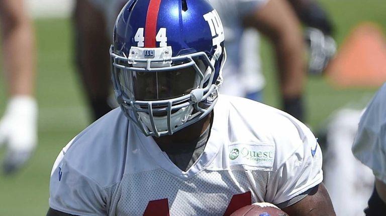 New York Giants running back Andre Williams runs
