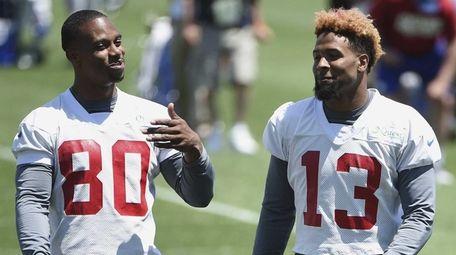 New York Giants wide receivers Victor Cruz, left,