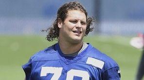 New York Giants defensive tackle Markus Kuhn looks