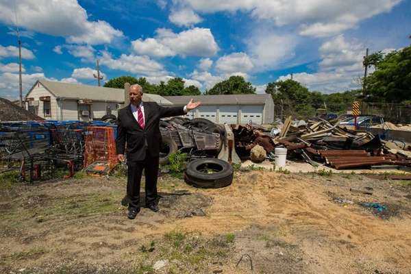 Freeport Mayor Robert T. Kennedy stands amidst the
