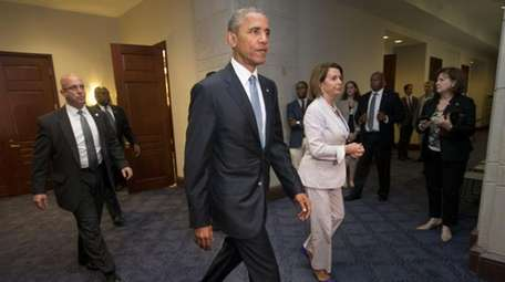 President Barack Obama and House Minority Leader Nancy
