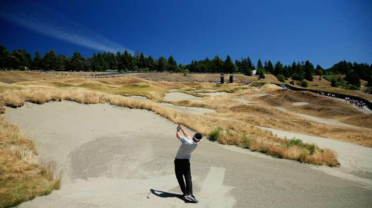 Louis Oosthuizen plays a bunker shot during a